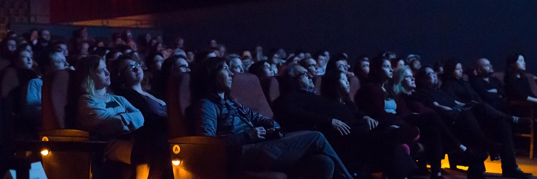An audience watches a movie at the IU Cinema.