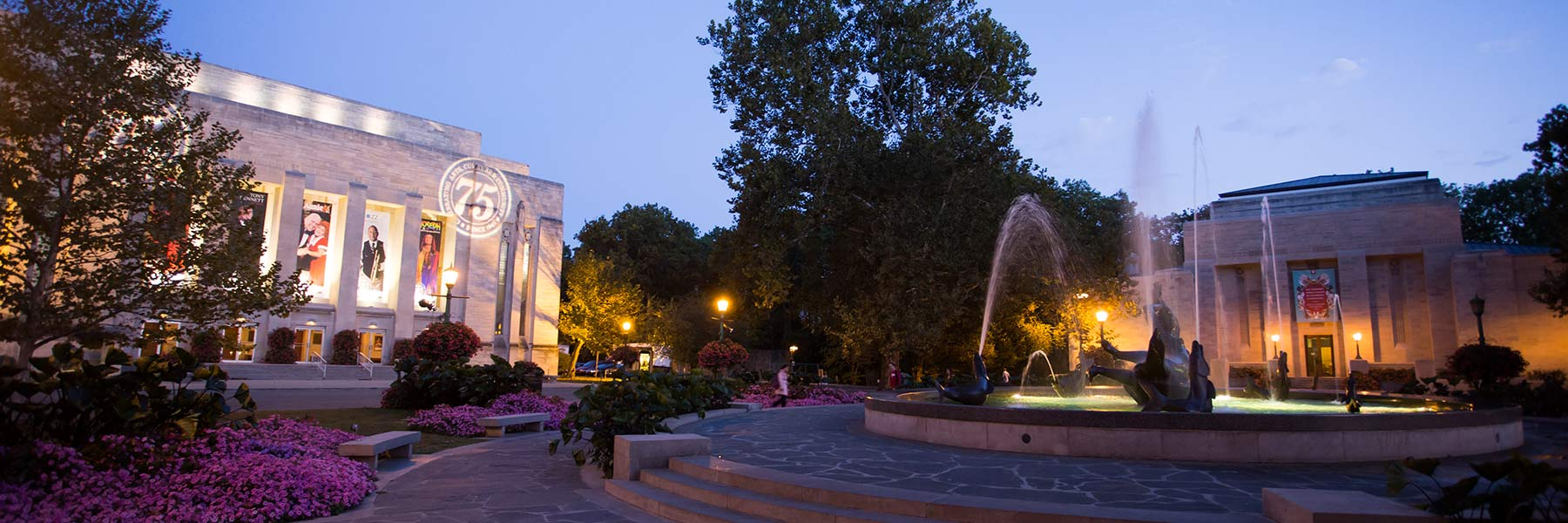 The IU Auditorium and Showalter Fountain in the evening.